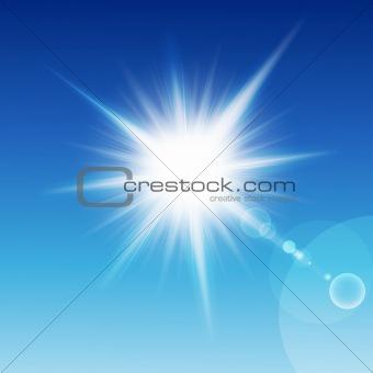 Sun with rays on a blu sky