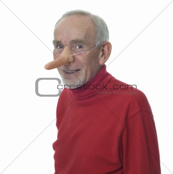 Old man wearing long false nose and smiling