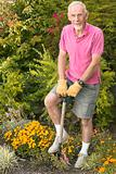 Old man digging his garden