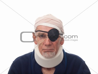 Old man with bandaged head and eye patch