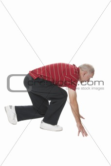 Senior man performing squat exercise