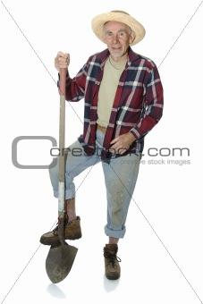 Old gardener leaning on spade
