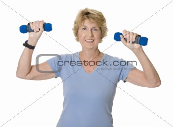 Active senior woman using hand weights