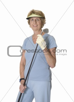 Active senior woman with golf club