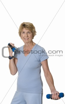 Active senior woman exercising with hand weights