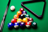 Pool game balls against a green