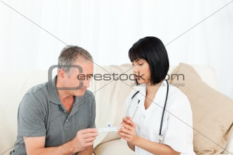 Nurse showing pills to her patient