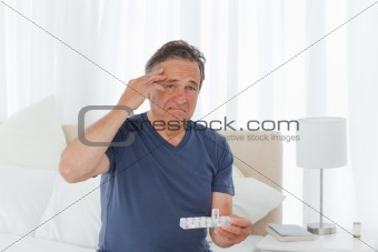 Sick man taking his pills