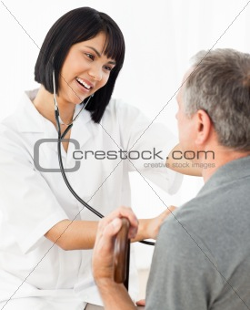 Senior laughing with his nurse
