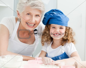 A little girl with her grandmother looking at the camera
