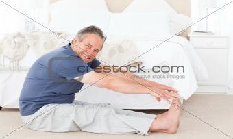 Mature man stretching