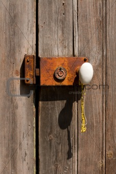 Ancient Wooden Door with Metal Grungy Lock.