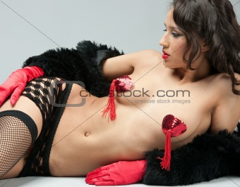 glamour girl posing on fur and stockings