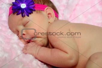 Sleeping newborn girl