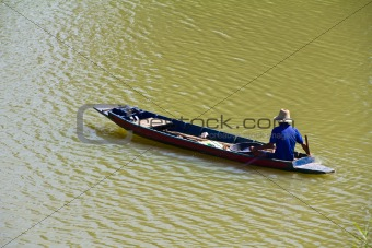 Fisherman rowing on the river
