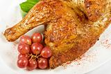 Half roasted chicken closeup