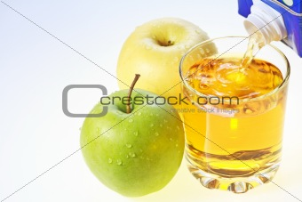 Green and yellow apples and glass of juice
