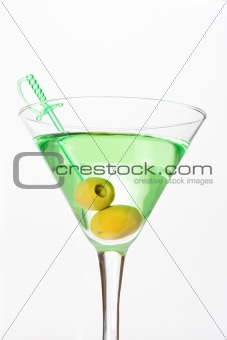 Green alcohol cocktail with martini and olives