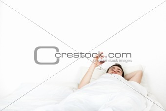 Alone young man in bed