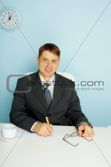 Smiling business man at office