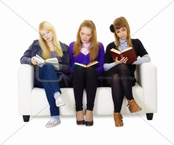 Three girls teen carefully read the books