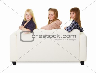 Three girls teens sitting on the couch