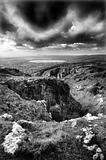 Stunning black and white landscape of canyon gorge view into dis