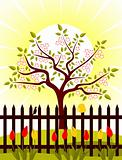 flowering tree behind fence