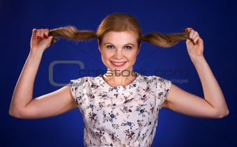 Beautiful red head woman holding her ponytails