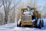 Snow covered tractor