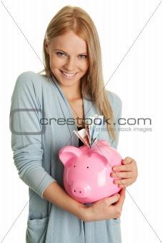 Beautiful young woman saving money