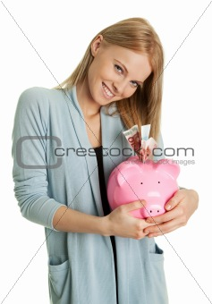 Beautiful young woman saving money