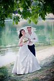Newlyweds portrait in sunny summer park