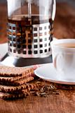 french press, cup of herbal tea and some fresh cookies