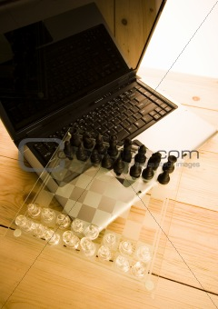 Glass chess & Laptop