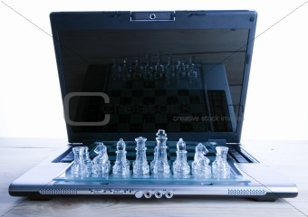 Glass chess &amp; Laptop