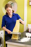 Female making Fettuccine