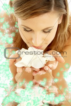 smelling rose petals in water with flowers