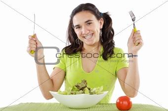 adolescent eating a salad