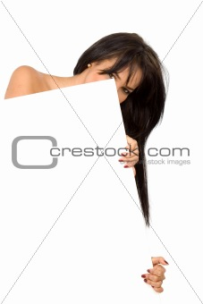 girl hiding behind a billboard