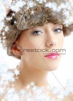 lovely beauty in winter hat with snowflakes