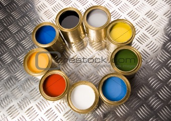 Paint and gold cans