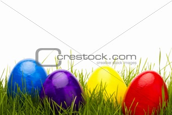 four easter eggs in grass