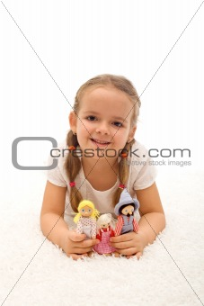 Little girl playing with her puppets family