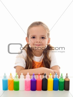 Little girl and her coloring kit