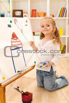 Little artist girl painting her dream house