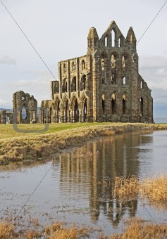 Ancient english abbey with reflection