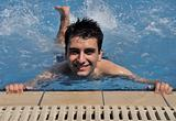 Man in water gymnastics