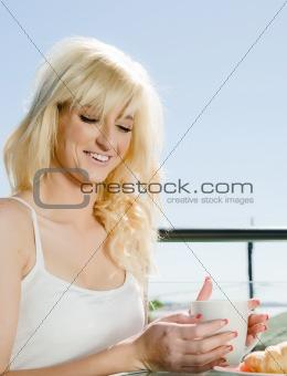 beautiful woman having coffee in cafe