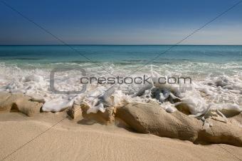 Caribbean beach shore with rocky